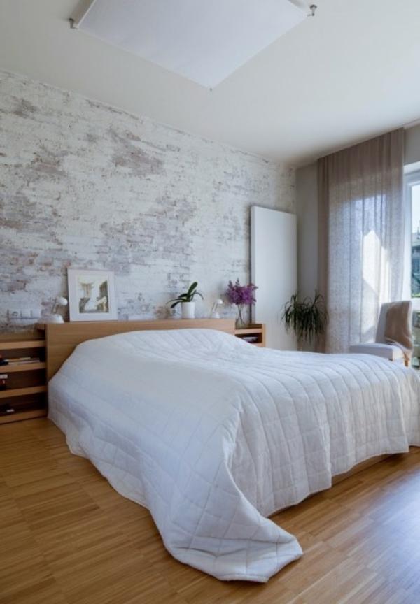 Eine Backstein Mauer in City Stil in weiß und grau