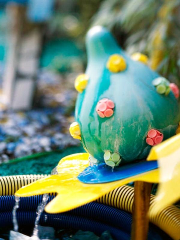 blumenbrunnen wasser ball deko idee gartenkunst