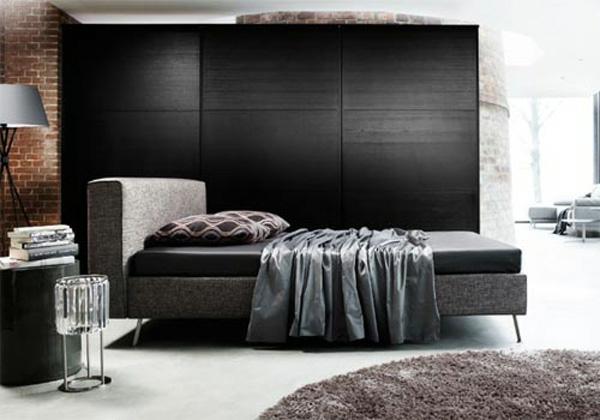 braune ziegelwand schwarze wände design idee schlafzimmer