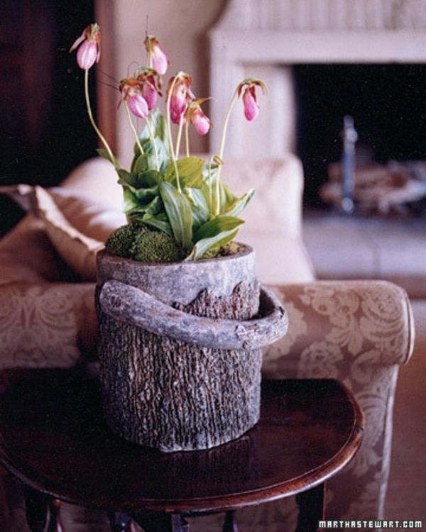 fruehlingsblumen blumentopf baumstumpf idee dekoration haus