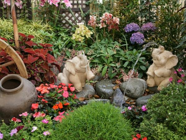 garten ideen gartengestaltung steine stauden gartenpflanzen elefanten figuren springbrunnen