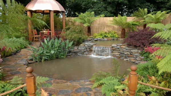 gartenteich wasserfall gartenbau steinplatten farn wasserpflanzen
