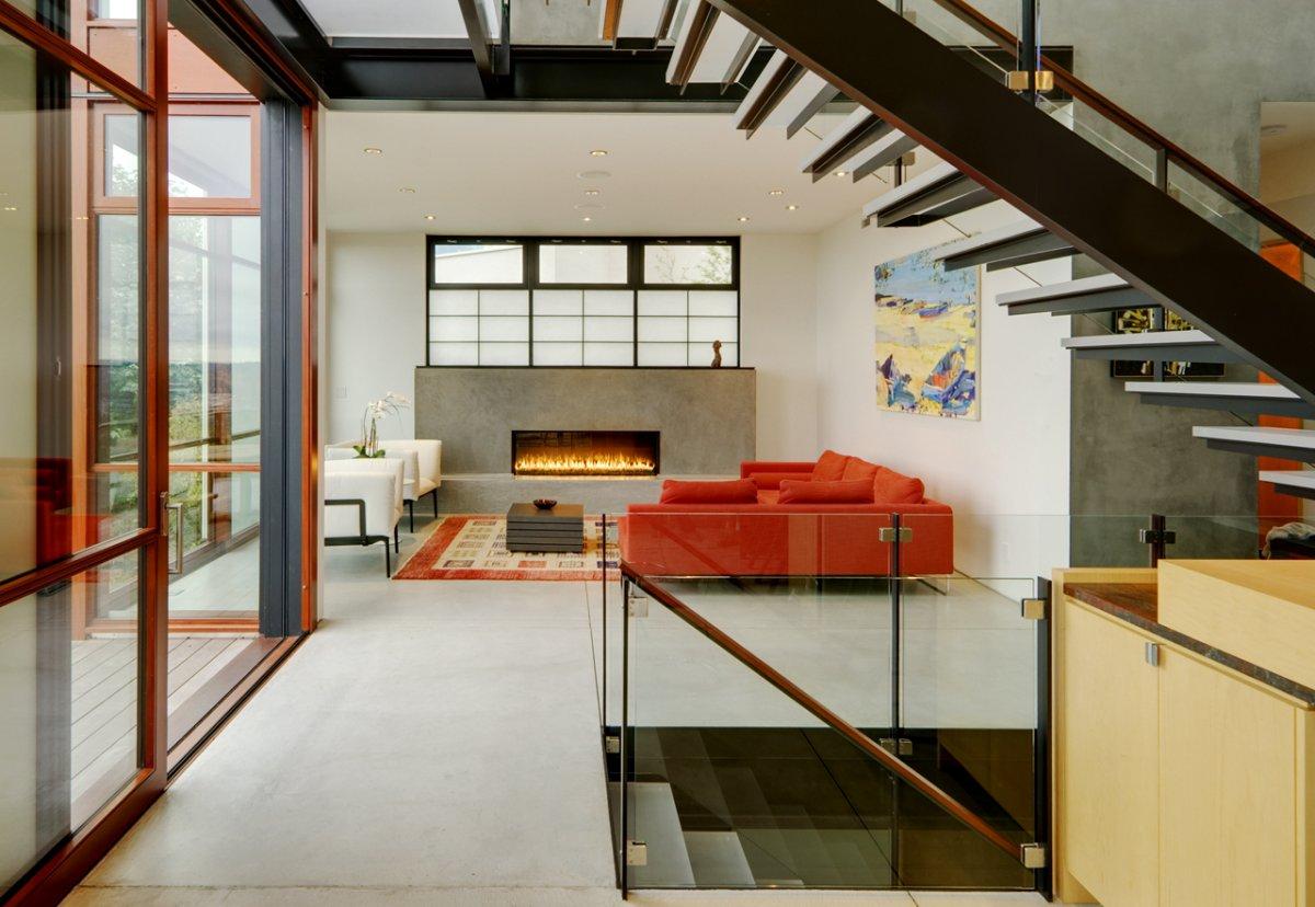 gemuetlich ausstattung weisse orange sofas treppe