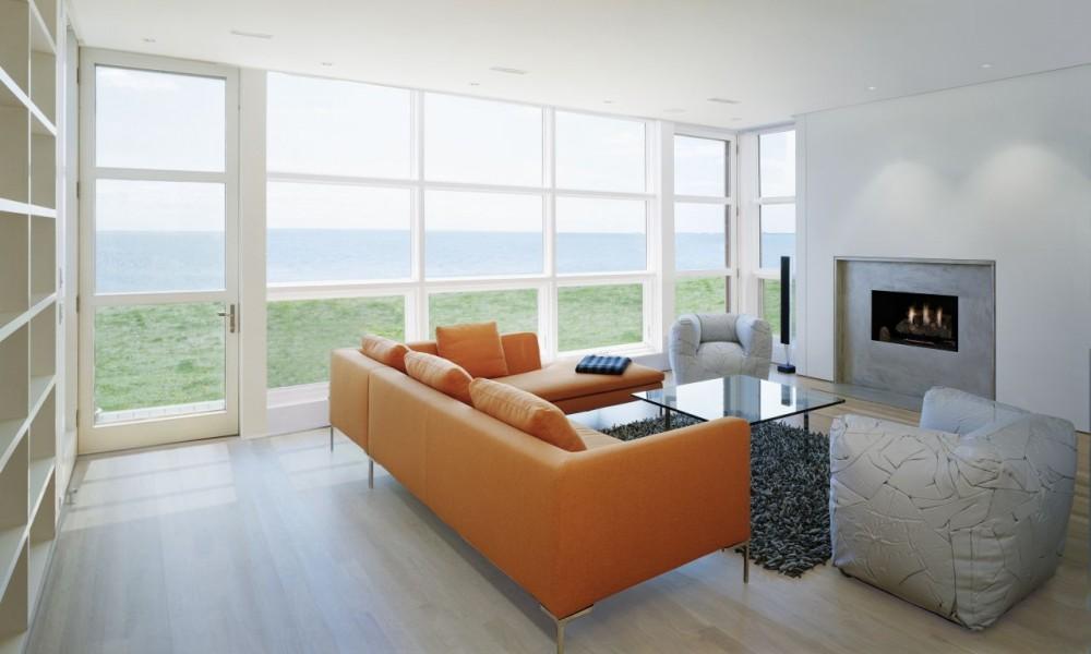 minimalistisch meerblick orange ledersofa glastisch