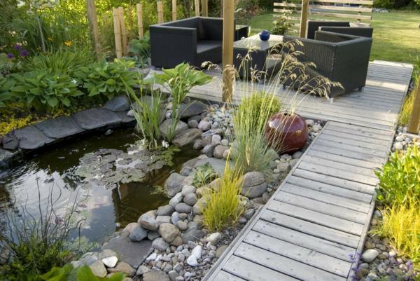 rattanmöbel gartenteich gehwege anlegen natursteine wasserpflanzen