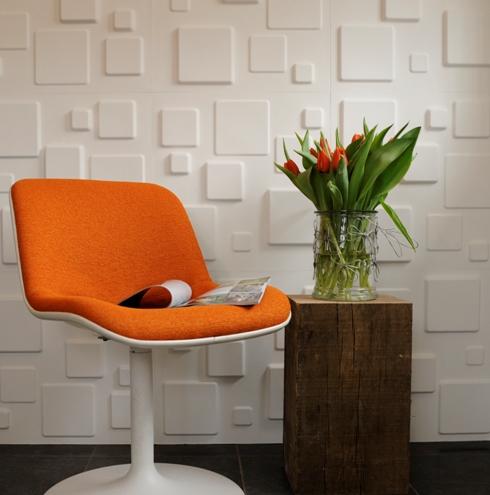 3d wandverkleidung weiß quadraten orange bequem stuhl wohnzimmer