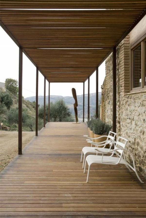 haus design minim alte windmühle stein holz veranda