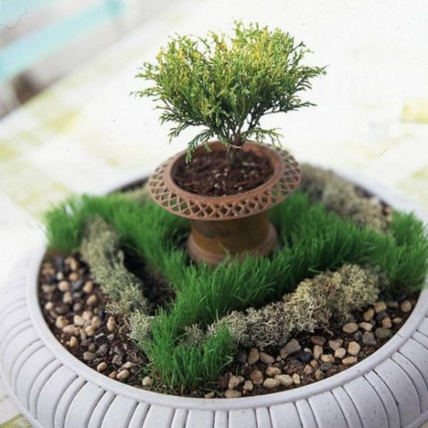 stilvoll verzierung grüne pflanzen kieselsteine