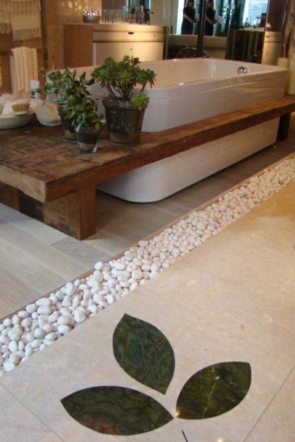 Badezimmer design mit grünen pflanzen und steinen zur dekoration