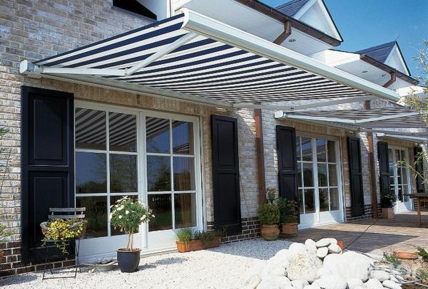 Terrasse und garten sonnenschutz ideen sonnensegel und for Markise balkon mit tapeten wohnzimmer modern grau