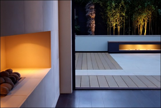 designer terrasse gestaltung kamin holz wasserfall