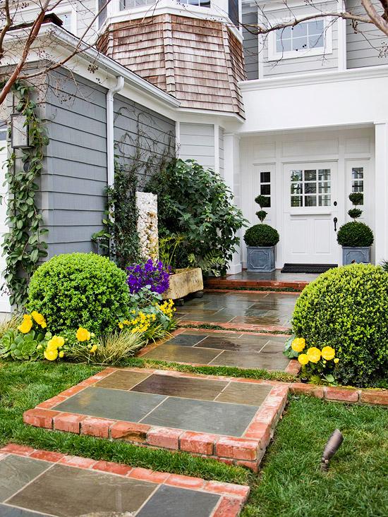 gartenpfade und gartengänge busch gelbe blumen