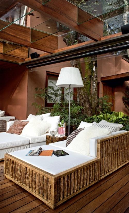 veranda  holz holzboden außenmöbel sofa glas zimmerdecke