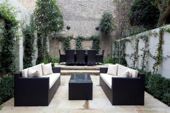 coolen garten gestalten schwarz tisch sofas auflagen weiß
