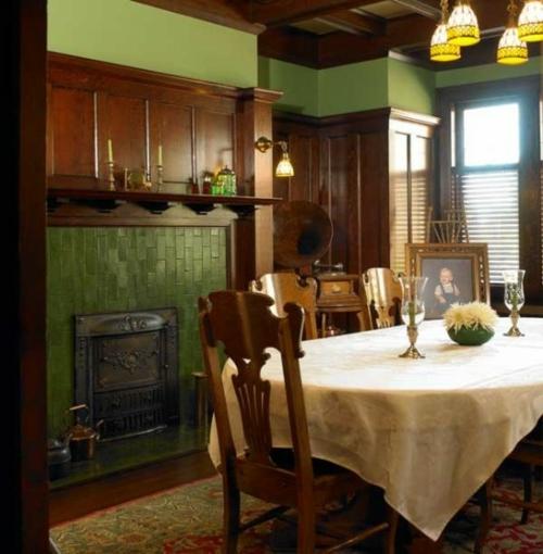 elegante esszimmer designs idee grün einbaukamin wände