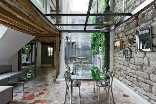 Renovierte Maisonette Wohnung Herzen Paris esszimmer ziegelmauer