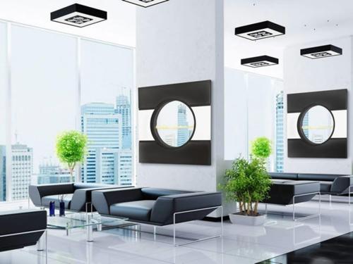 Das Wohnzimmer attraktiv einrichten leder sofa pflanzen behälter