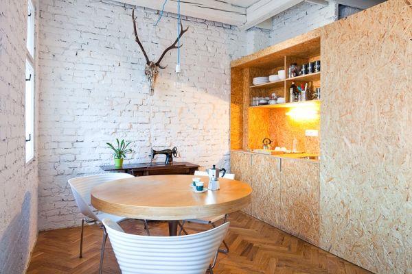 Homeoffice mit skandinavischem Design in Bratislava ziegelwand runder tisch