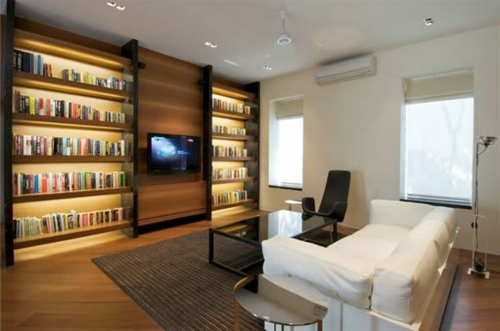 bücherregale beleuchtet leseecke wohnzimmer bildschirm teppich