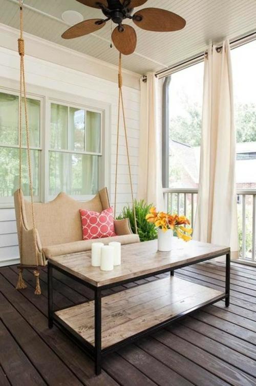 die veranda im sommer gestalten schaukel klassich bequem beige