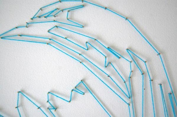 diy künstlerische ideen aus garn portrait an der wand nahaufnahmae