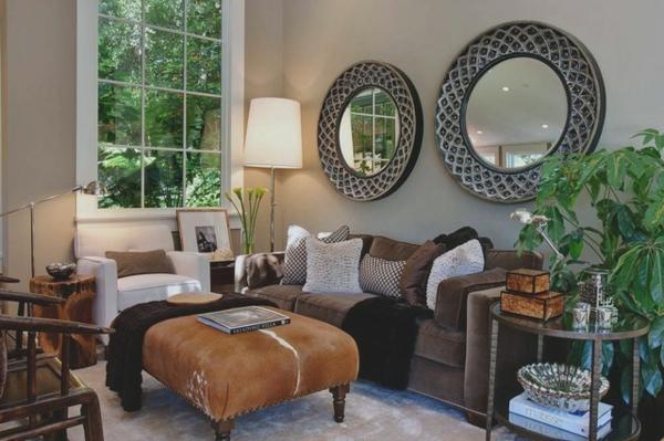 eine robuste zimmerpflanze runde ornamenten spiegel