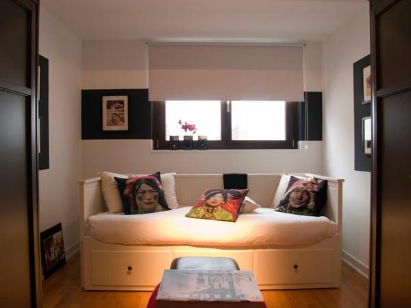 coole einrichtung für penthouse wohnung bunte portraitenkissen