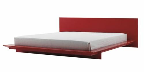 modernes bett im schlafzimmer gestell rot glanzvollkopfteil