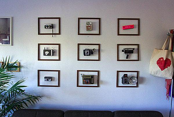 sammlung mit flair alte fotokameras in rahmen