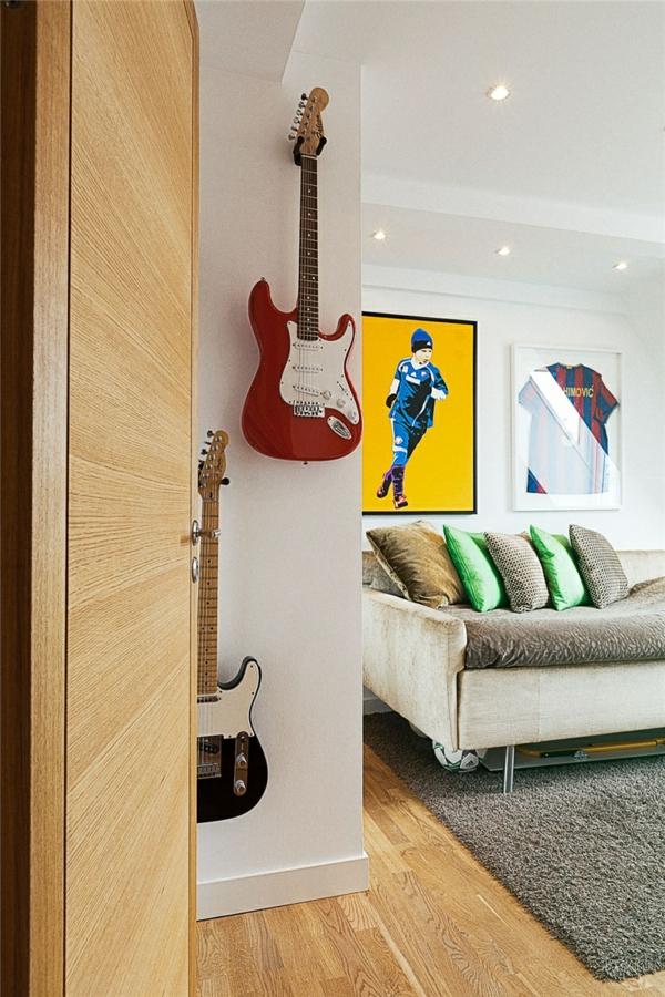 loftwohnung in schweden elegant gitarren hängend sofas teppich