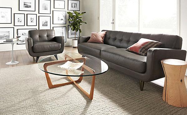 Eklektisches Interior Design sofas leder schwarz rund glasplatte
