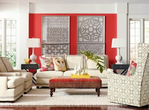 Gemütliches Wohnzimmer einrichten rot wand dekoration kissen