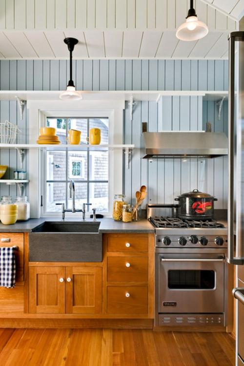 Spüle in der Küche orange regale fenster platten wandgestaltung
