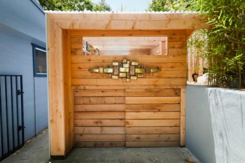 kompakte Baracke mit Lagerraum holz platten design architektur
