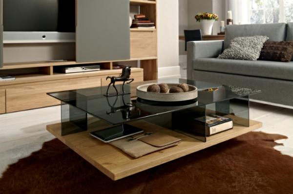 moderne wohnzimmer einrichtung brauner fellteppich tischplatte aus dunklem glas