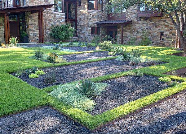 modernes landschaftsbau design graue kieselsteine subtropische pflanzen
