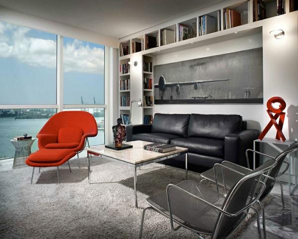 raffinierte penthouse wohnung schwarzleder kardinalroter sessel