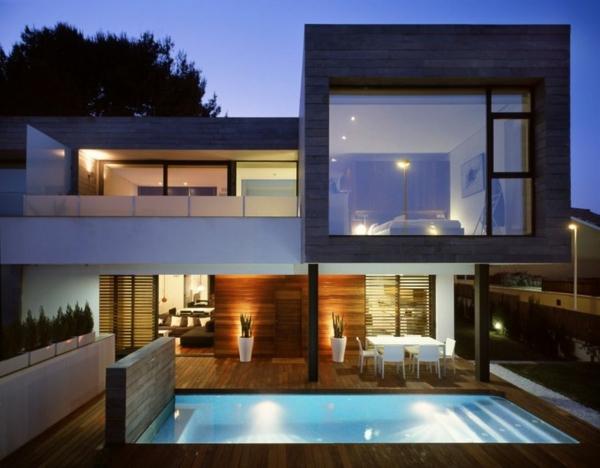 zeitgenössische luxus doppelhäuser beleuchteter pool