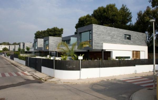 zeitgenössische luxus doppelhäuser in grau und weiß