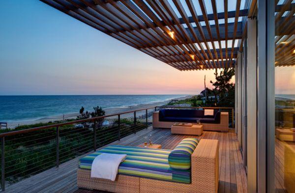 Elegante Pergola Design Gestaltung terrasse meer liegen rattan