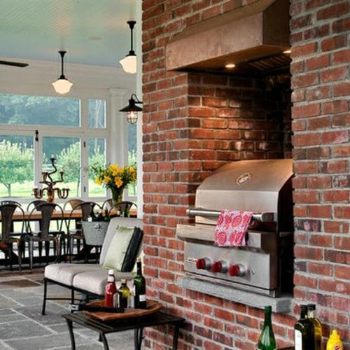 Küchen Design mit eingebautem Grill modern crisp architekten