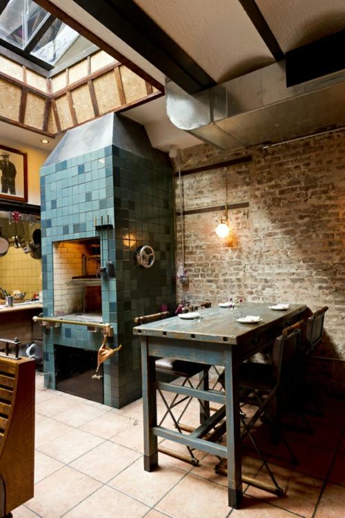 Küchen Design mit eingebautem Grill modern fliesen blau rustikal tisch