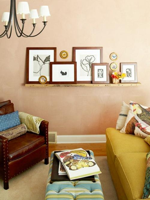 Kunstvolles cooles Wohnzimmer einrichten leder sessel braun kronleuchter regal