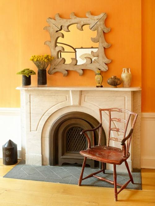 Moderne Wandfarbe fürs Zuhause orange leuchtend einbaukamin wandspiegel