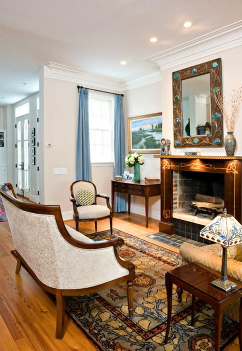 Ornamentale Kunst beim Interior Design einbaukamin verziert sessel