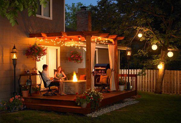feuerstelle pergola beleuchtung hinterhof romantisch atmosphäre