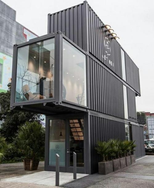 minimalistisch container haus design grau fassade metall fenster pflanzen kübel