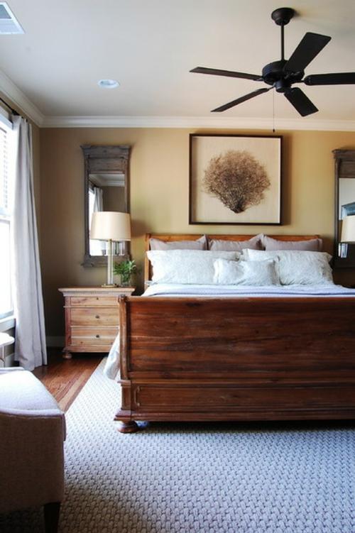 Warmes rustikal eingerichtetes Haus schlafzimmer doppelbett kissen