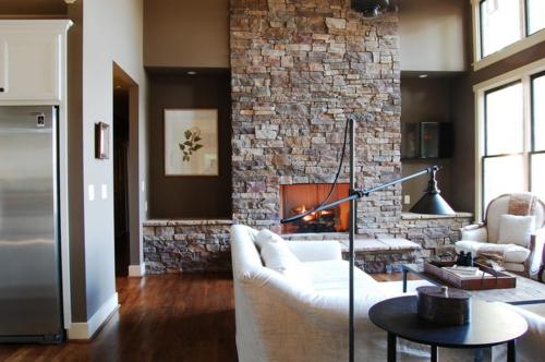 Warmes rustikal eingerichtetes Haus steinwand gestaltung wohnzimmer