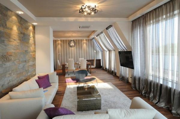 exklusive penthousewohnung natursteine wand